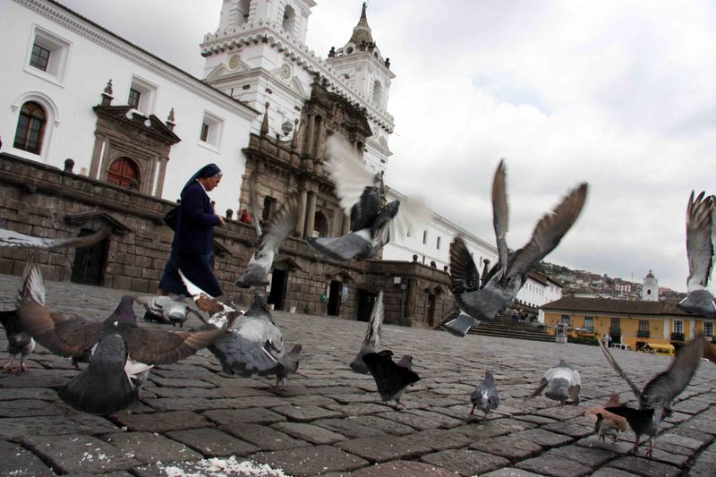 Nun in the central square. Quito, Ecuador
