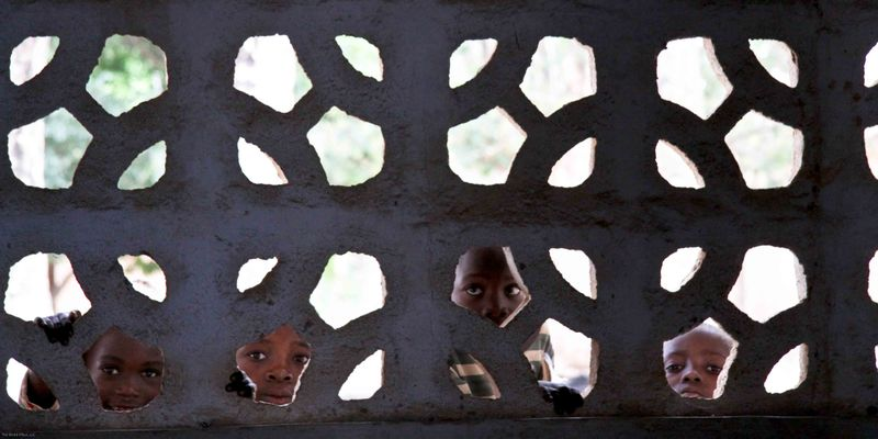 Kande, Malawi - kids looking it school library