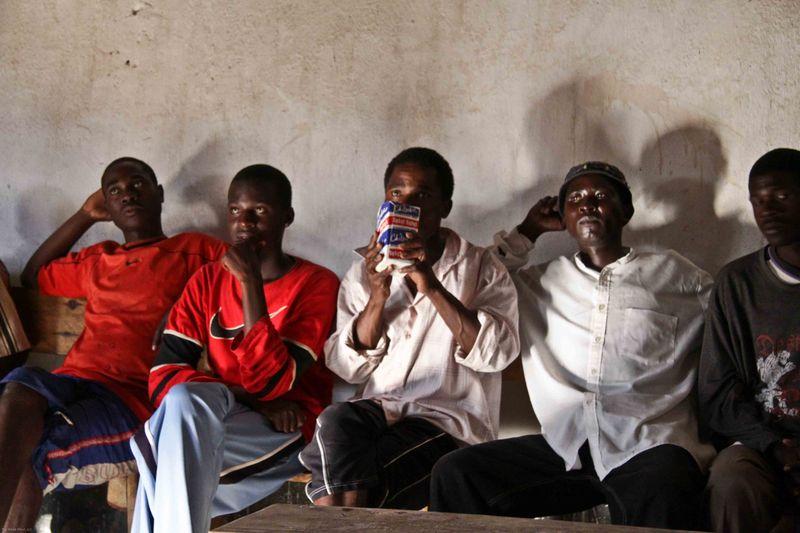 Kande, Malawi - Men in the bar