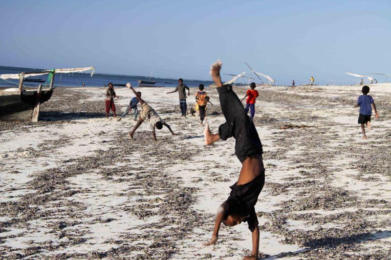 Nungwi, Zanzibar - kids flipping on the beach