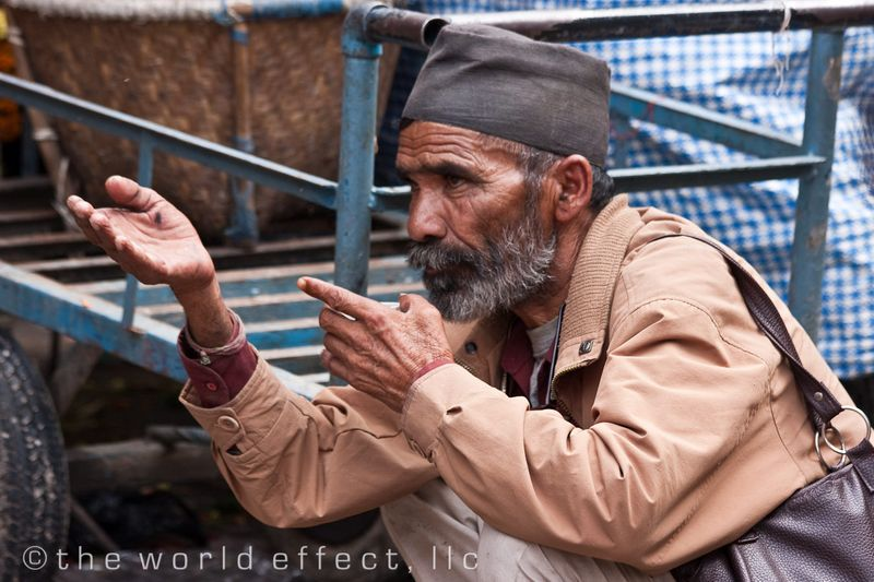A man having a conversation while having tea. Kathmandu, Nepal