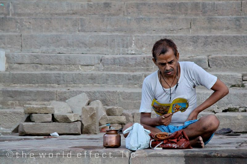 Man reading after bathing in the Ganges. Varanasi, India