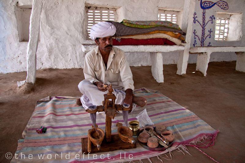 Rajastanian Man with opium tea still.