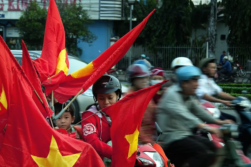 Morning before the game: Flags for sale. Ho Chi Minh City, VIetnam