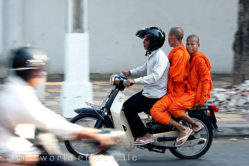 monks catching a lift. Phnom Penh, Cambodia
