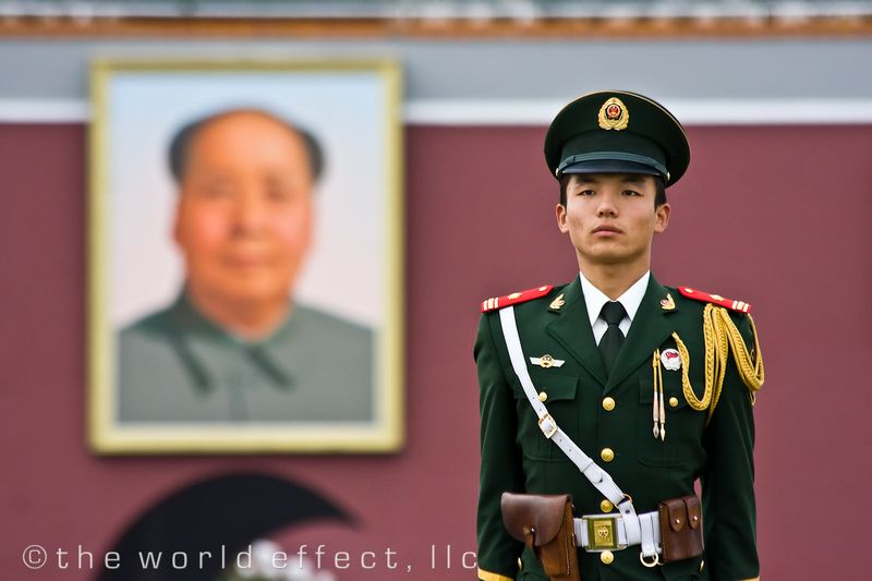 Guard at Tiananmen Square, portrait of Chairman Mao in the background