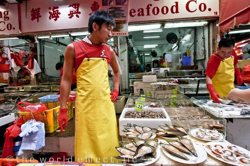 Smoke Break at a fish market. Hong Kong