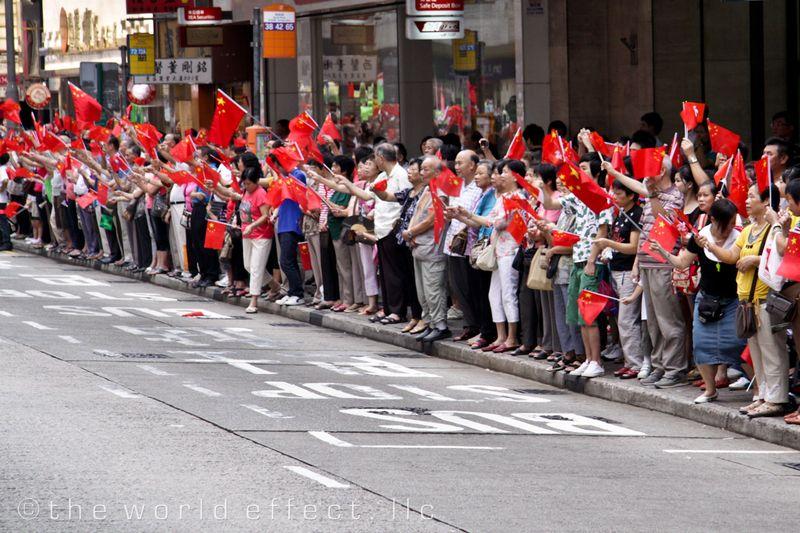 Hong Kong Parade watchers waving China flags. Hong Kong