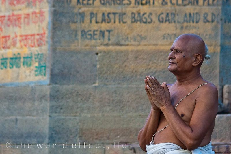 Man praying at the Ganges River. Varanasi, India
