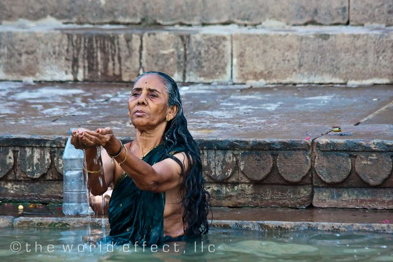 Woman praying in the Ganges. Varanasi, India