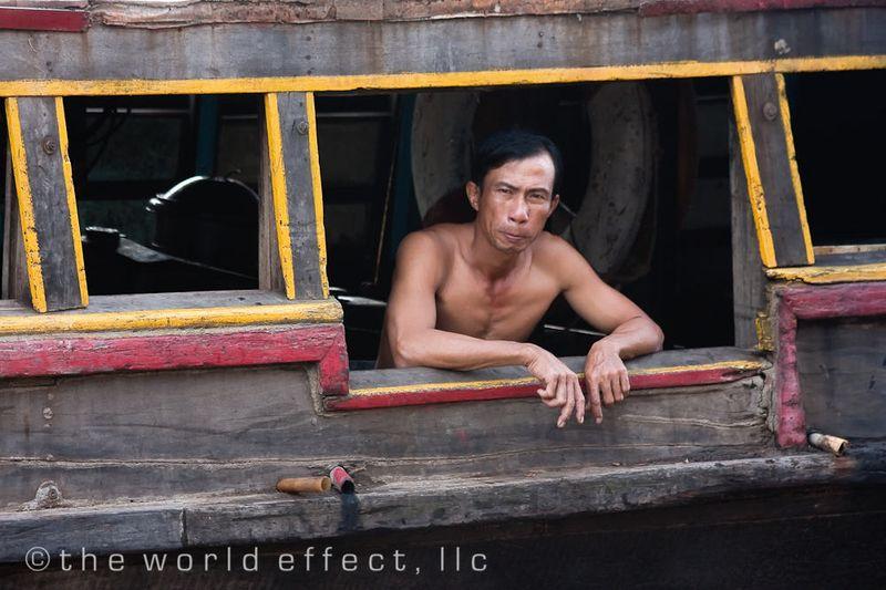 Boatman. Mekong Delta, VIetnam