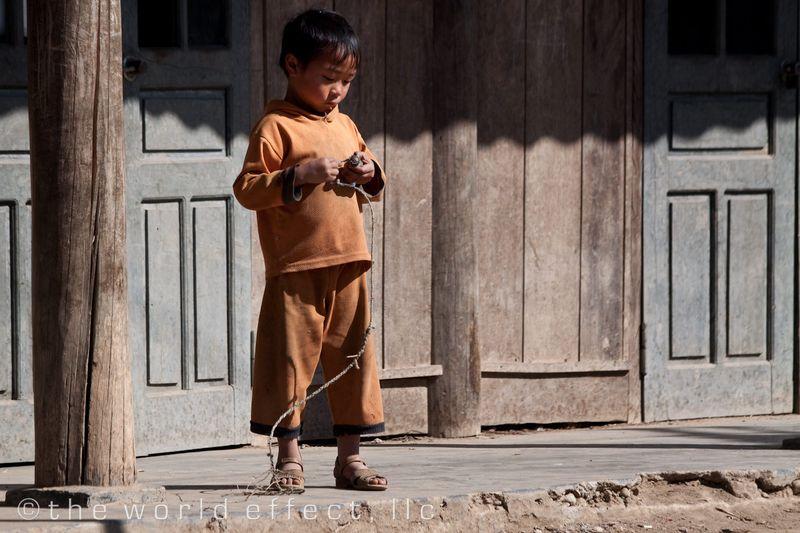 Sapa Vietnam - Kid playing Tops